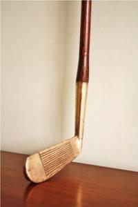 Club de golf avec manche en bois